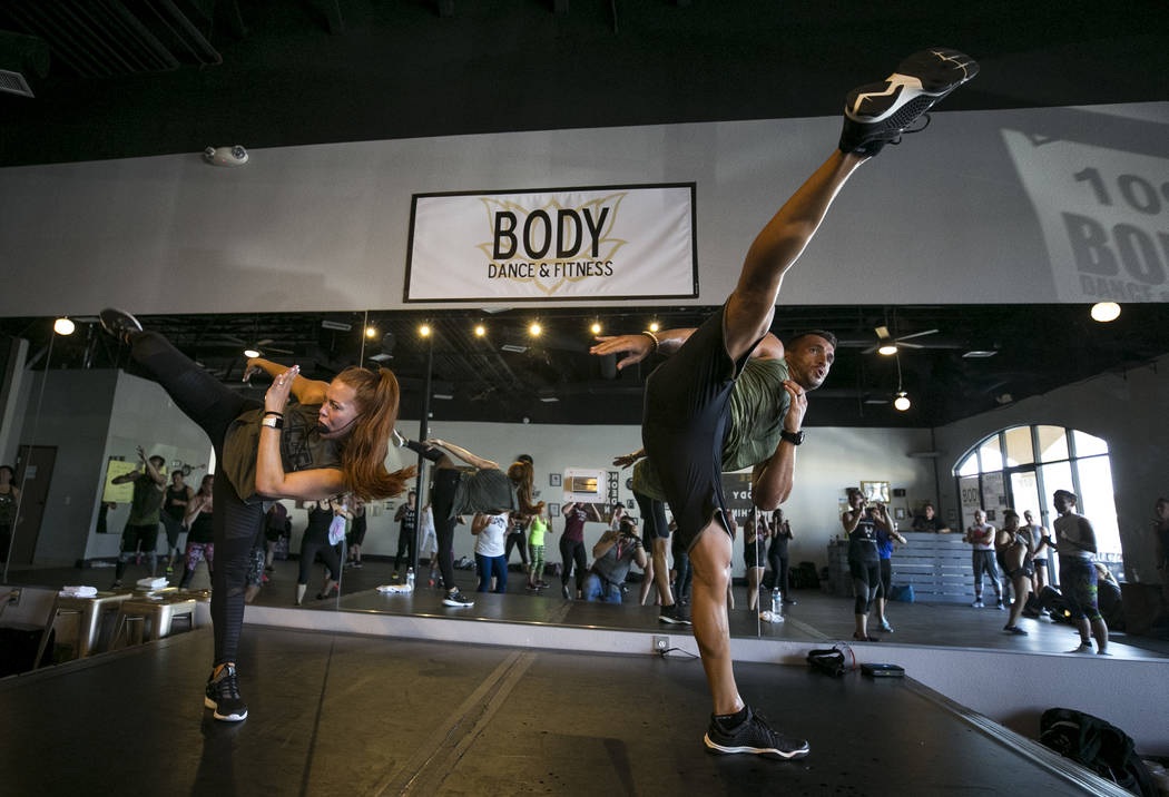 Beachbody LIVE trainers and Core De Force co-creators Jericho McMatthews, left, and Joel Freeman lead their MMA-inspired instructor training workshop at Body Dance and Fitness studio at 7885 West  ...