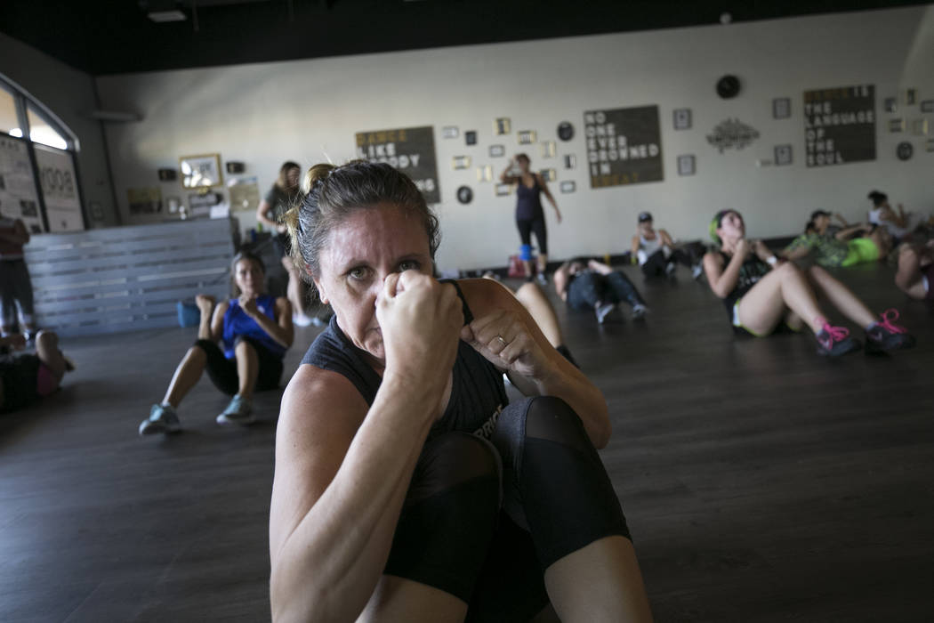 Angela Thornhill of Lake Havasu throws a punch as she takes part in the Core De Force instructor training workshop at Body Dance and Fitness studio at 7885 West Sahara Ave., Sunday, July 23, 2017, ...