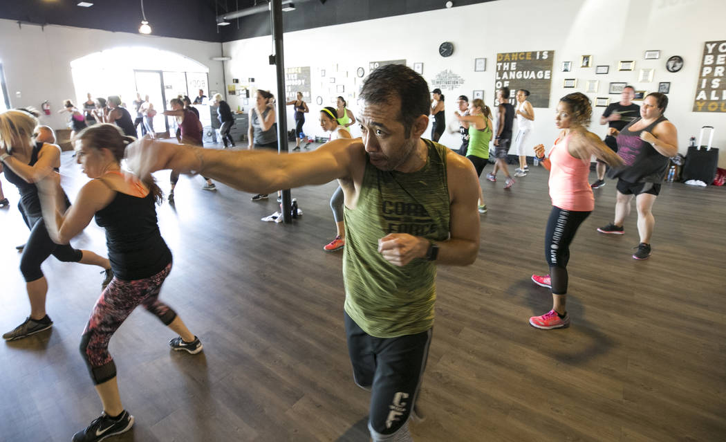 Las Vegas resident Dennis Macaranas takes part in the Core De Force instructor training workshop at Body Dance and Fitness studio at 7885 West Sahara Ave., Sunday, July 23, 2017, in Las Vegas. (Ri ...