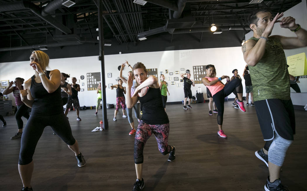 Michelle Perkins, from left, Allison McCarthey and Dennis Macaranas take part in the Core De Force instructor training workshop at Body Dance and Fitness studio at 7885 West Sahara Ave., Sunday, J ...