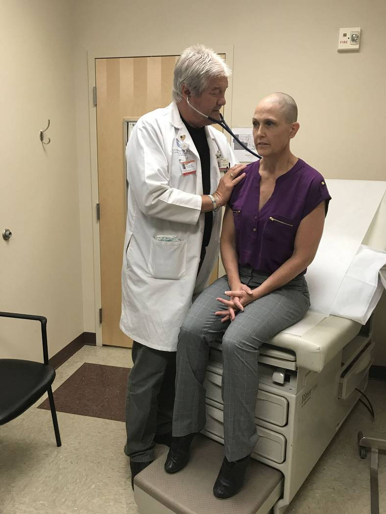 Comprehensive Cancer Centers of Nevada oncologist Dr. Paul Michael examines Las Vegas  paramedic Tricia Klein, who three years ago was diagnosed with an aggressive brain tumor similar that of Ariz ...