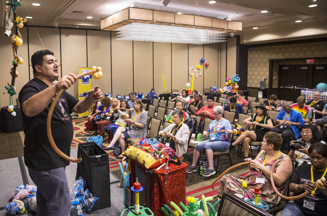 Fabrizio Bolzoni, left, leads a balloon art class during the Bling Bling Jam Balloon Convention on Tuesday, July 25, 2017, at the Golden Nugget hotel-casino, in Las Vegas. Benjamin Hager Las Vegas ...