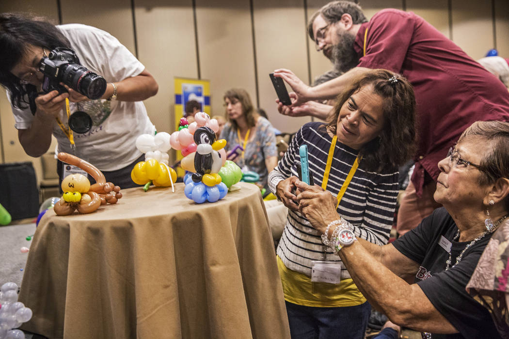 Convention attendees take photos of balloon art during the Bling Bling Jam Balloon Convention on Tuesday, July 25, 2017, at the Golden Nugget hotel-casino, in Las Vegas. Benjamin Hager Las Vegas R ...