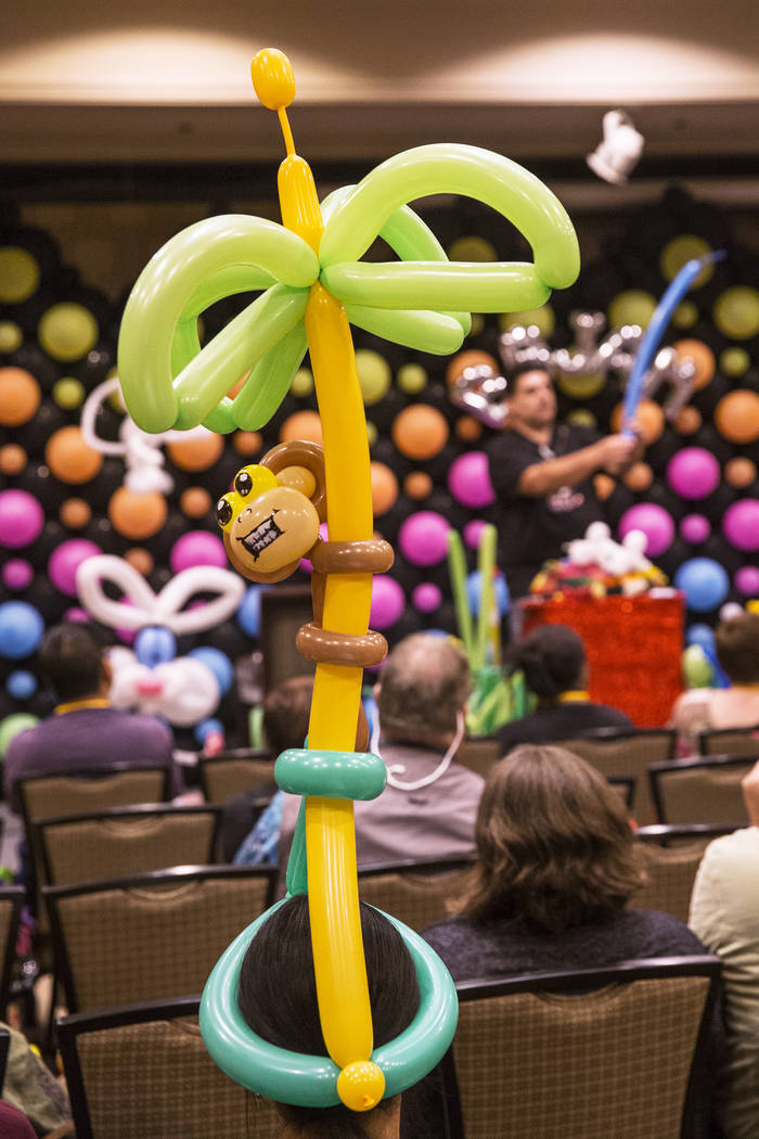 Convention attendees wear colorful attire while listening to Fabrizio Bolzoni lead a balloon art class during the Bling Bling Jam Balloon Convention on Tuesday, July 25, 2017, at the Golden Nugget ...