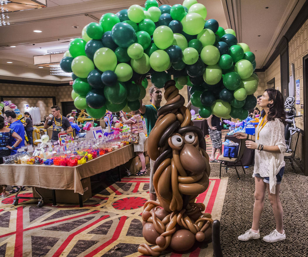 Tam Timmers, right, and husband Trev work on a large balloon tree during the Bling Bling Jam Balloon Convention on Tuesday, July 25, 2017, at the Golden Nugget hotel-casino, in Las Vegas. Benjamin ...