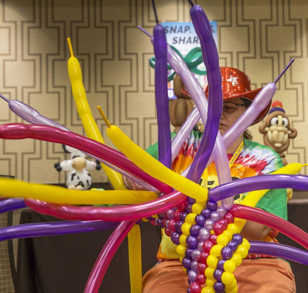 Diana Root works on the magic carpet for an Aladin float during the Bling Bling Jam Balloon Convention on Tuesday, July 25, 2017, at the Golden Nugget hotel-casino, in Las Vegas. Benjamin Hager La ...