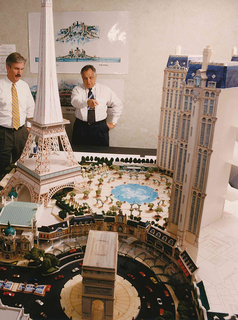 Scott Walls, left, and Joel Bergman look at a model of Paris Las Vegas while the hotel-casino was being planned. (Courtesy)
