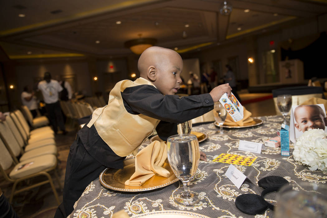 Ayden Brown, 2, diagnosed with terminal cancer at the age of one, reaches for stickers during a fundraiser by his family  at the Suncoast on Saturday, July 22, 2017. Erik Verduzco Las Vegas Review ...