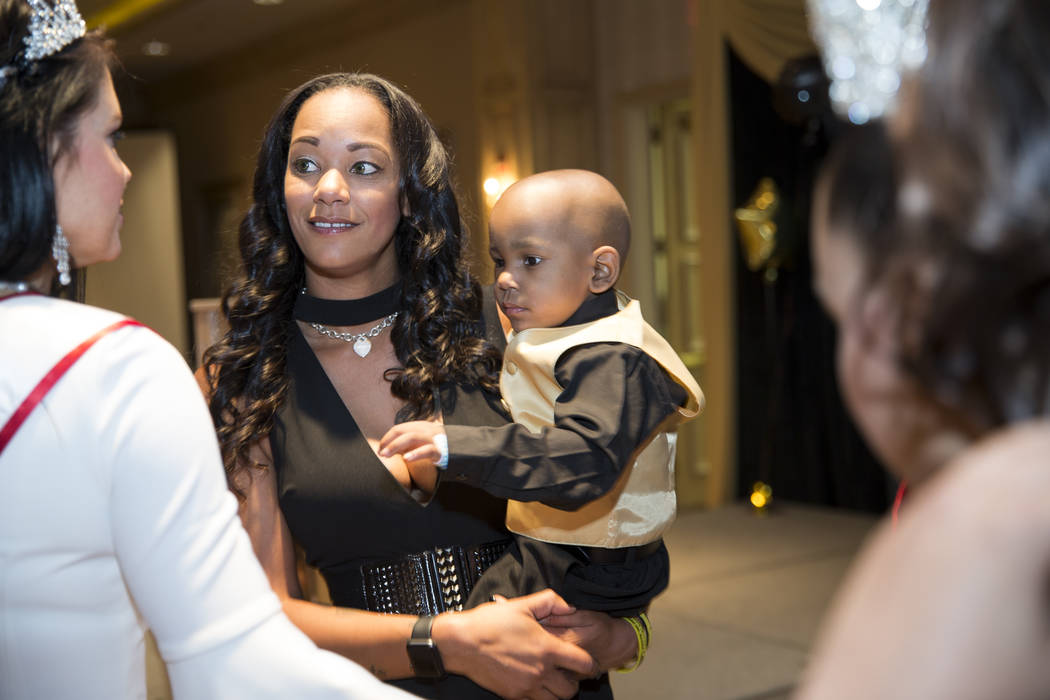 Lindsey Licari, left, with her 2-year-old son Ayden Brown, 2, who was diagnosed with terminal cancer at the age of one, during a fundraiser for Brown at the Suncoast on Saturday, July 22, 2017. Er ...