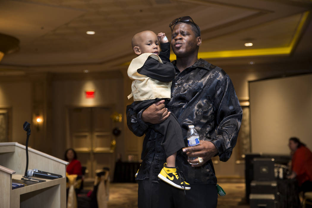 Jerome Debow with 2-year-old son Ayden Brown, who was diagnosed with terminal cancer at the age of one, during a fundraiser for Brown at the Suncoast on Saturday, July 22, 2017. Erik Verduzco Las  ...