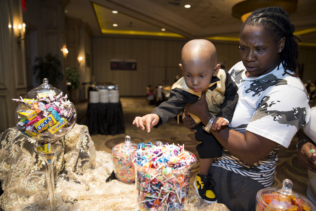 Jerome Debow with her 2-year-old godson Ayden Brown, who was diagnosed with terminal cancer at the age of one, during a fundraiser for Brown at the Suncoast on Saturday, July 22, 2017. Erik Verduz ...