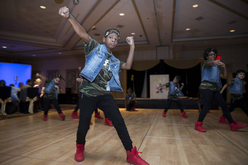 Freddy Horne, 11, performs during a fundraiser for Ayden Brown, who was diagnosed with terminal cancer at the age of one, at the Suncoast on Saturday, July 22, 2017. Erik Verduzco Las Vegas Review ...