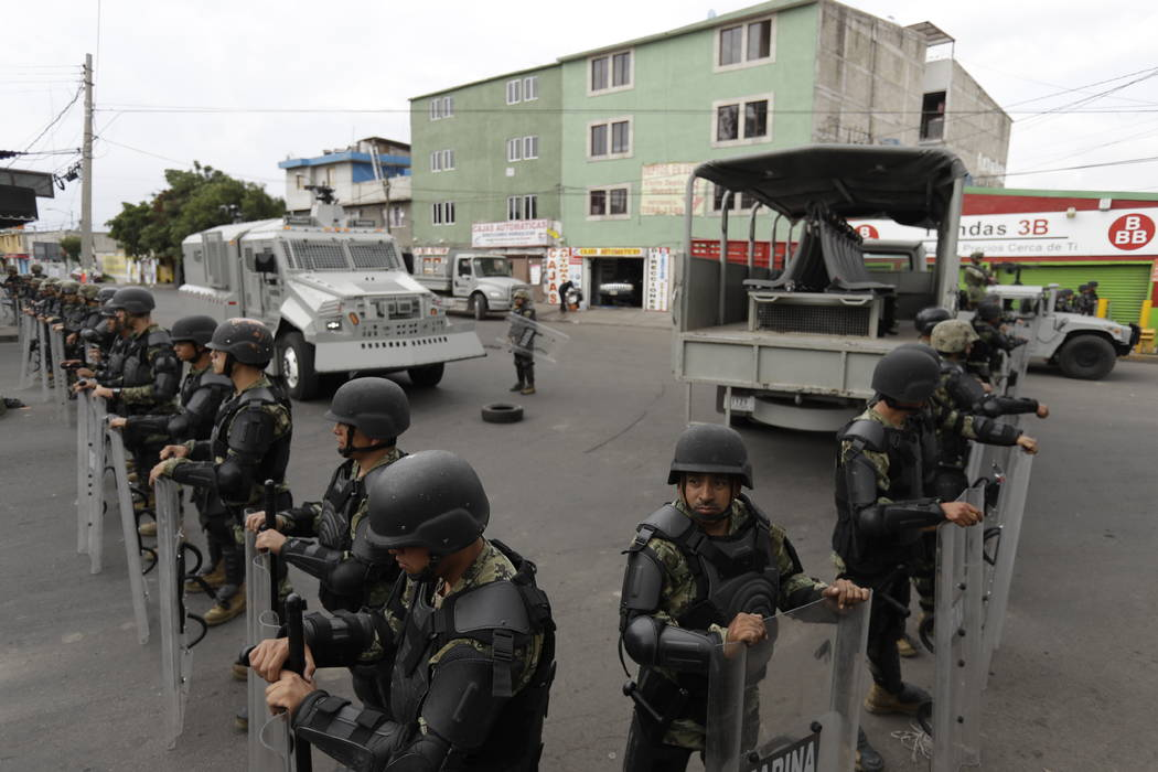 Marines block off the area where the suspected leader of a drug gang and seven others were killed, according to the Navy, in southern Mexico City, Thursday, July 20, 2017. In a statement Thursday, ...