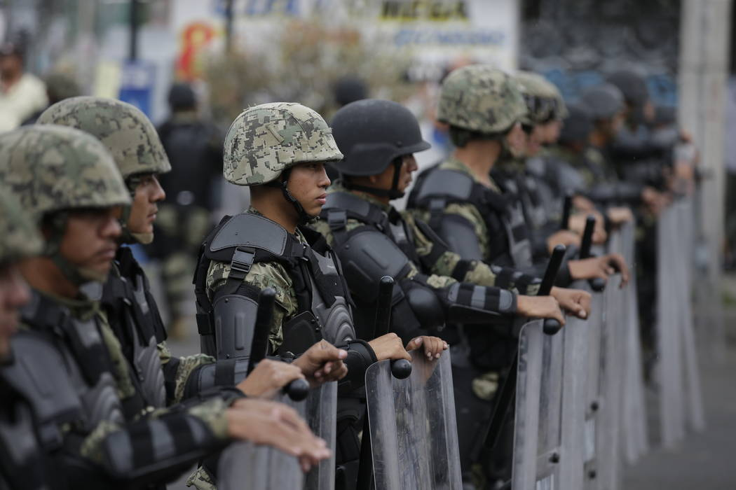 Marines block access to the site where the suspected leader of a drug gang and seven others were killed, according to the Navy, in southern Mexico City, Thursday, July 20, 2017. In a statement Thu ...