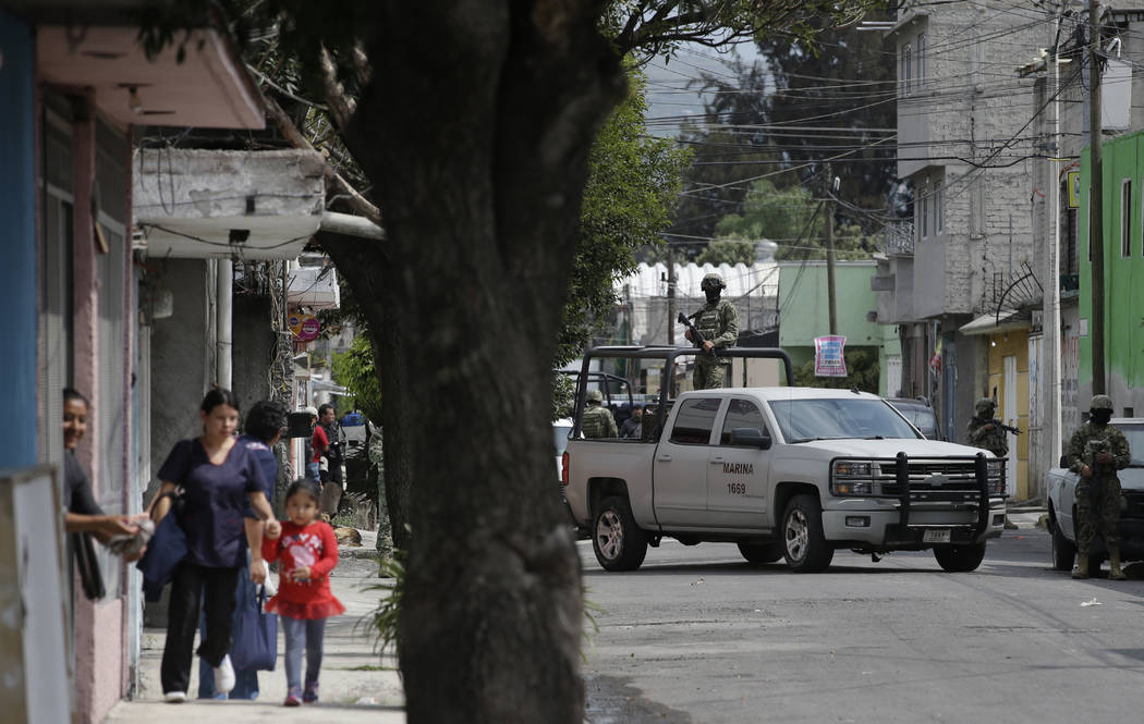 Marines block a street where the suspected leader of a drug gang and seven others were killed, according to the Navy, in southern Mexico City, Thursday, July 20, 2017. In a statement Thursday, the ...