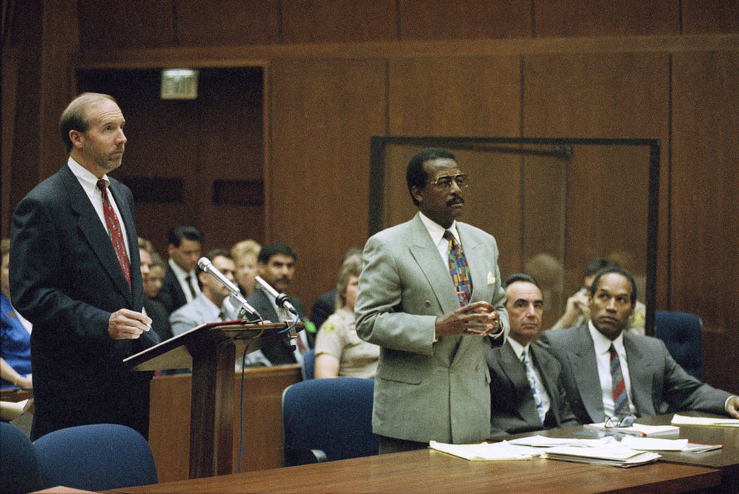 Prosecutor William Hodgman and defense attorney Johnnie Cochran Jr., stand during discussion with Judge Lance Ito at a hearing for O.J. Simpson in Los Angeles, July 29, 1994. (AP Photo/Nick Ut)