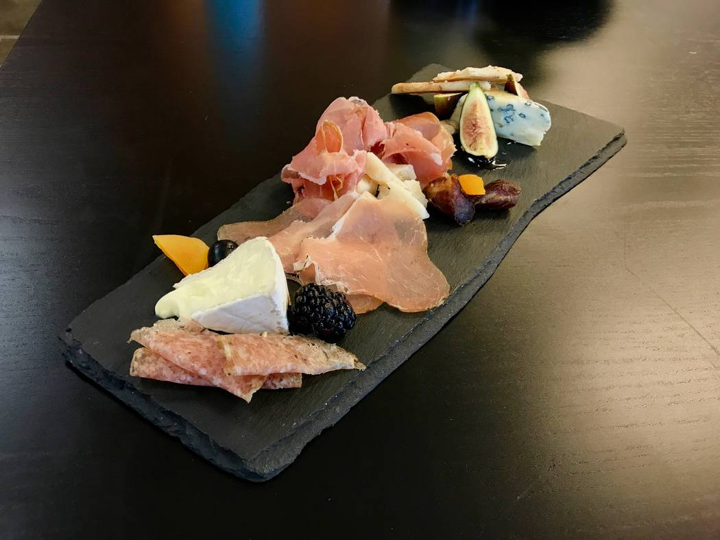 A charcuterie board including a triple cream brie from Four Fat Fowl creamery (left), lonzino from Angel's Salumi and Speck from Alto Adige. Boards for two people are $21.50 and can be customized. ...