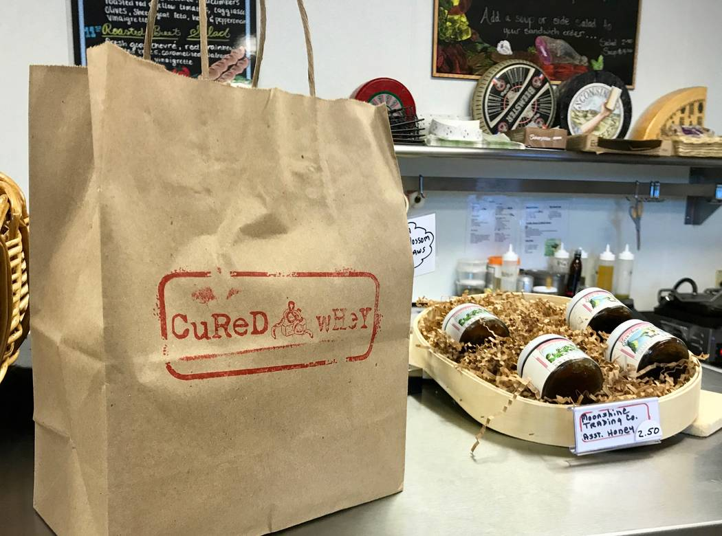 Cured & Whey is open from 10 a.m. to 5 p.m. Monday through Friday. Customers can shop for imported meats and cheeses while waiting for their sandwich or salad. (Madelyn Reese/View) @MadelynGReese