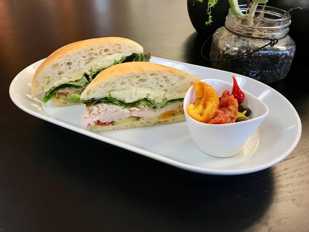 """""""The Turkey,"""" with pan-roasted turkey, asiago cheese, mayonnaise, Dijon, tomato and lettuce on a La Brea bread bun and a selection of pickled vegetables on the side. (Madelyn Reese/View) @MadelynG ..."""