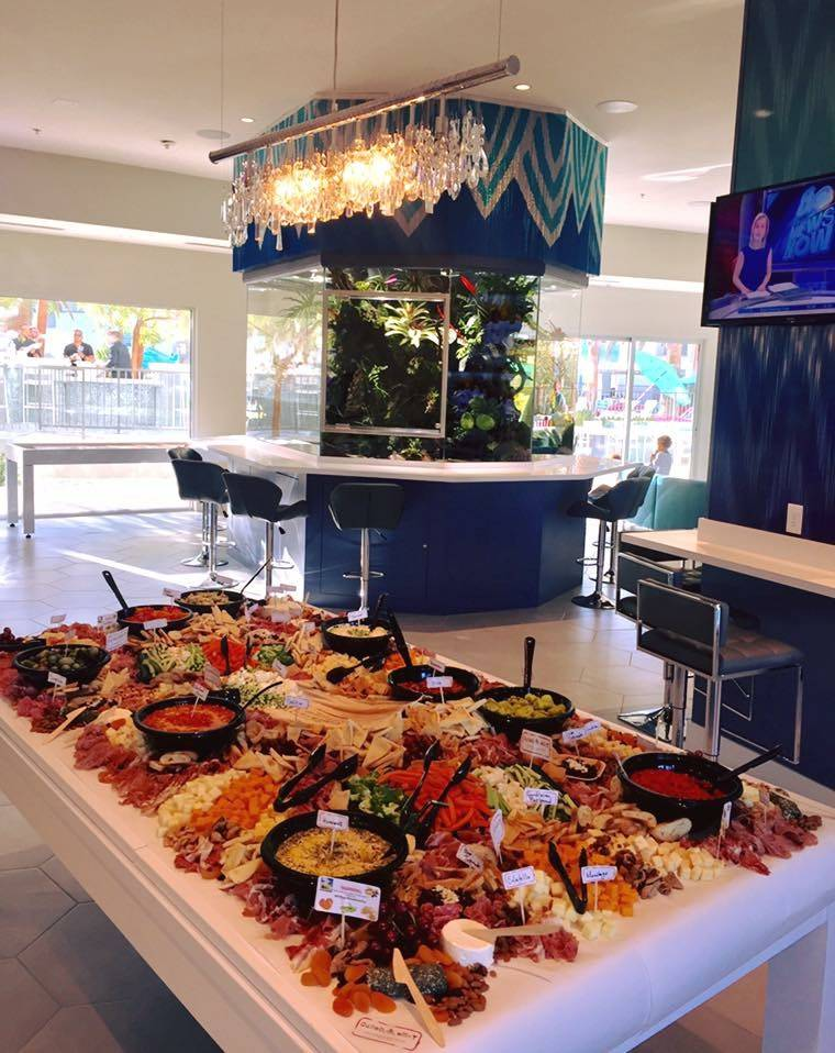 Cured & Whey also caters events, as seen here at an event for Element Hospitality Group at South Beach Resort on June 9. The team covered a pool table with a Mediterranean-inspired spread of c ...