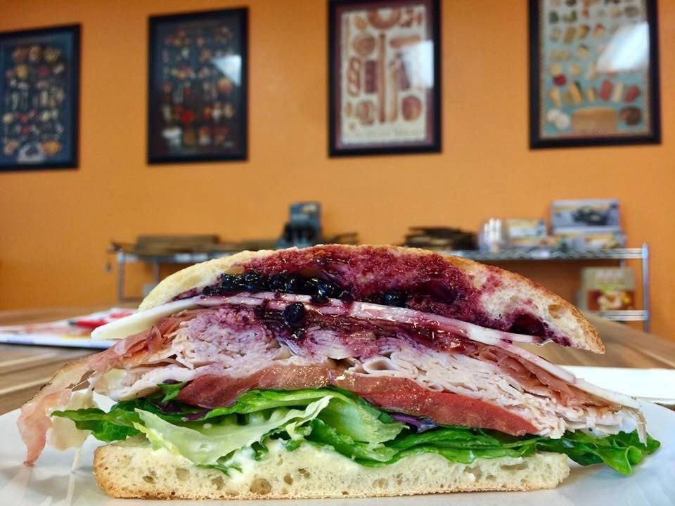 A sandwich lunchtime special with turkey, Speck, Havarti, huckleberry/blueberry compote, lettuce, tomato and mayonnaise. (Courtesy of Cured & Whey)