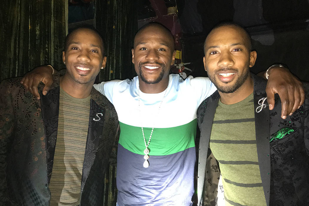 """Floyd Mayweather is shown with twin tappers Sean and John Scott after a performance of """"Absinthe"""" at Caesars Palace on Thursday, July 21, 2017. (Absinthe Las Vegas)."""