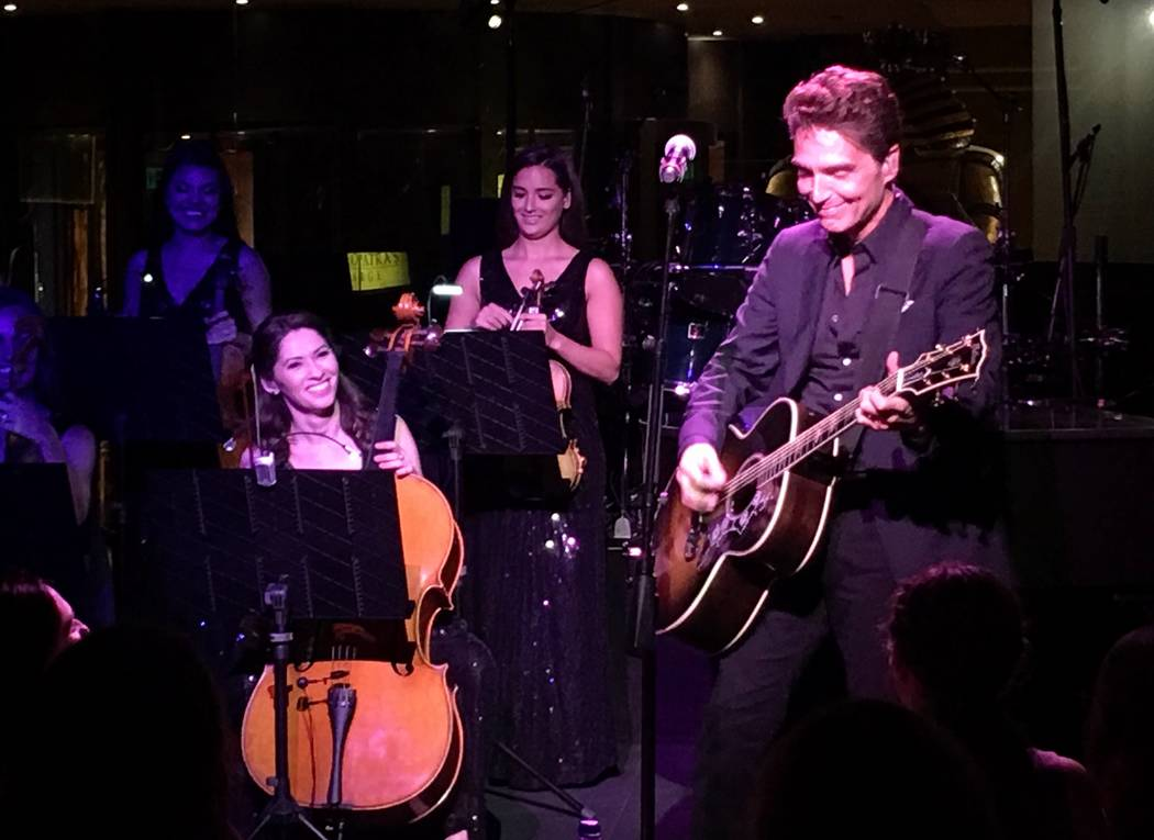 Richard Marx performs with members of the Bella Electric Strings -- Chandra Meilbaline on violin and Zuzana Engererova on cello -- at Cleopatra's Barge at Caesars Palace on Wednesday, July 20, 201 ...
