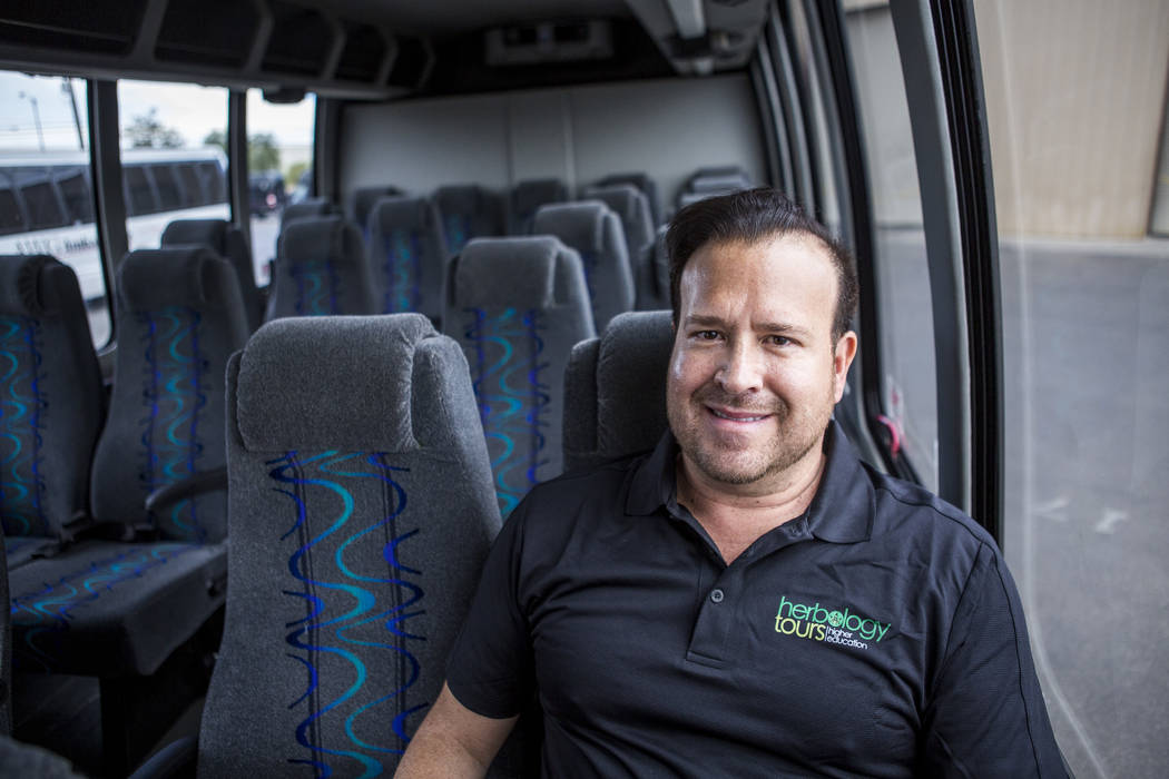 Matthew Miner, owner and CEO of Herbology Tours, stands on a bus at AWG Ambassador in Las Vegas on Monday, July 24, 2017. (Patrick Connolly/Las Vegas Review-Journal) @PConnPie