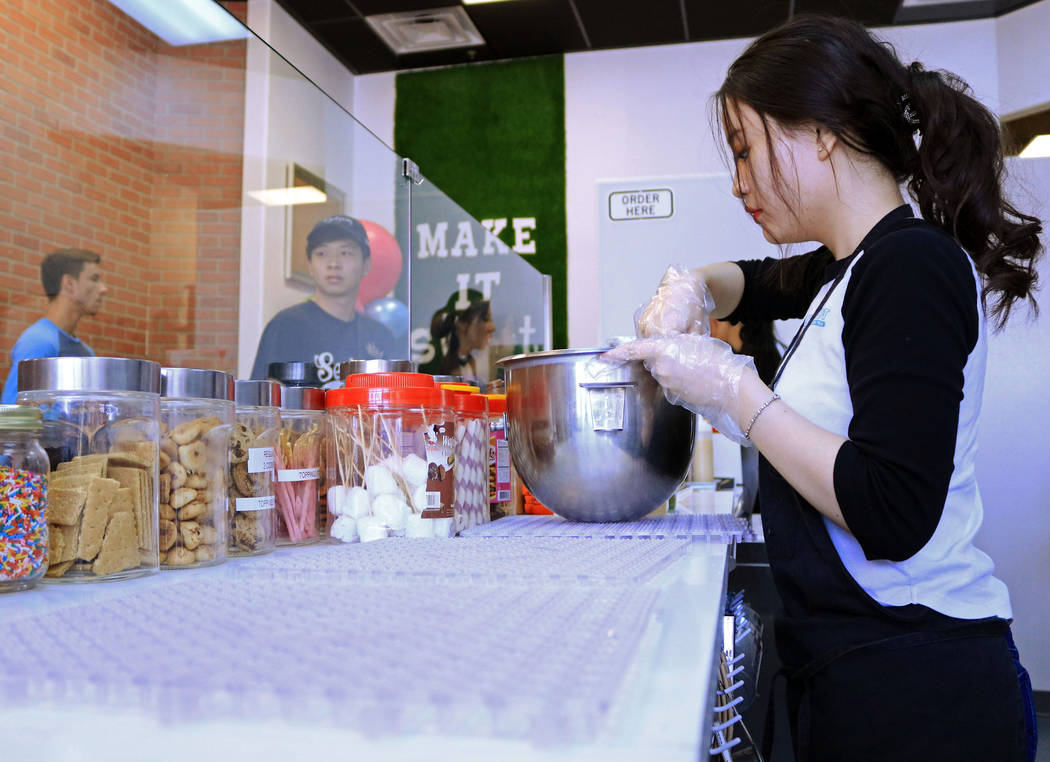 Chi Tran gets a customer's order ready during the grand opening for Sweetspot Nitrogen Ice Cream & Boba Tea in Las Vegas, Saturday, July 22, 2017. Gabriella Benavidez Las Vegas Review-Journal  ...