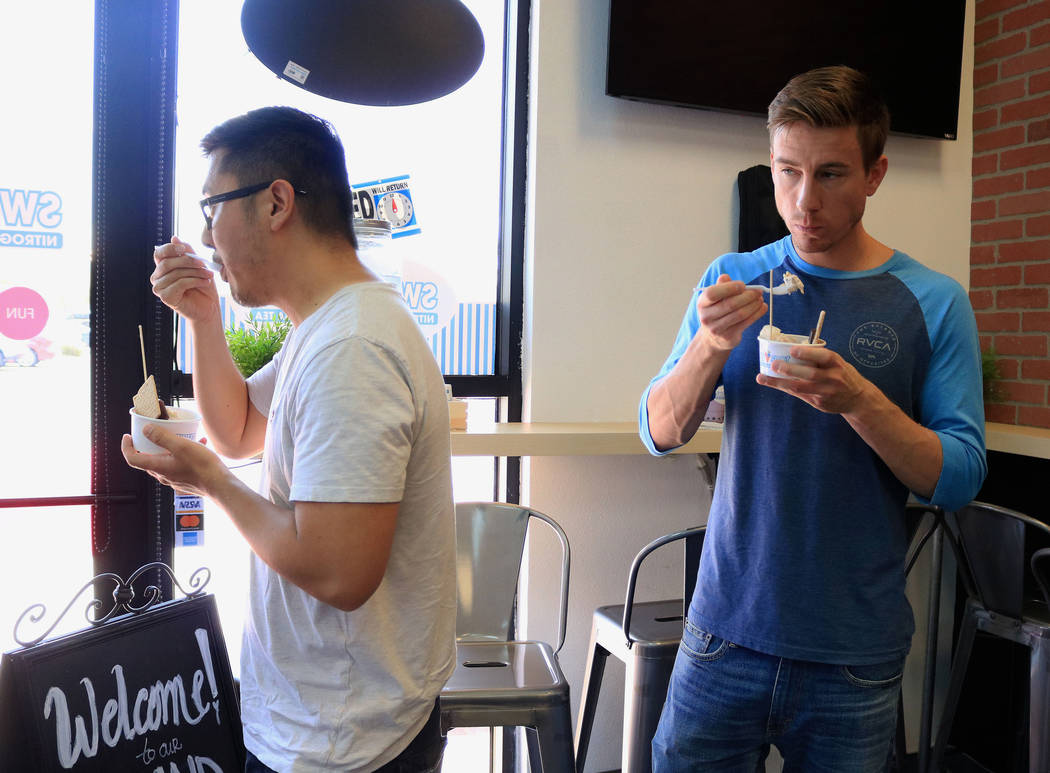 James Chong, left, and Jared Brandise eat ice cream during the grand opening for Sweetspot Nitrogen Ice Cream & Boba Tea, Las Vegas, Saturday, July 22, 2017. Gabriella Benavidez Las Vegas Revi ...