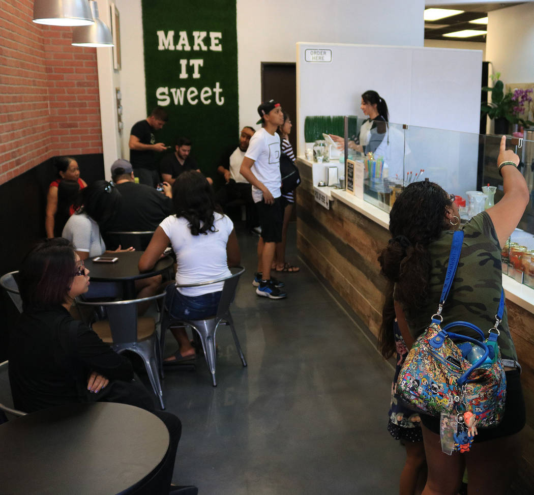 Customers line up while looking at the menu during the grand opening for Sweetspot Nitrogen Ice Cream & Boba Tea in Las Vegas, Saturday, July 22, 2017. Gabriella Benavidez Las Vegas Review-Jou ...