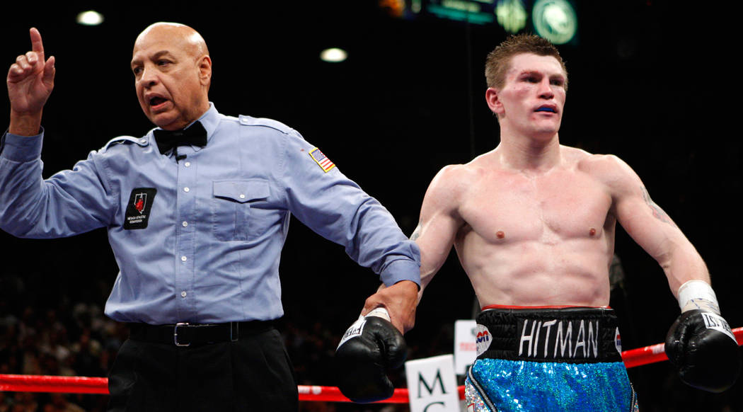 Ricky Hatton, of Great Britain, right, is penalized by referee Joe Cortez after being called for hitting Floyd Mayweather Jr. in the back of the head during their WBC welterweight boxing title fig ...