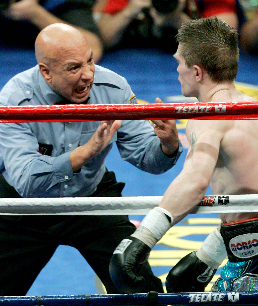 Referee Joe Cortez gives a count to Ricky Hatton of Great Britain after he was knocked down in the 10th round by Floyd Mayweather Jr., not shown,  in their super middleweight boxing match at the M ...