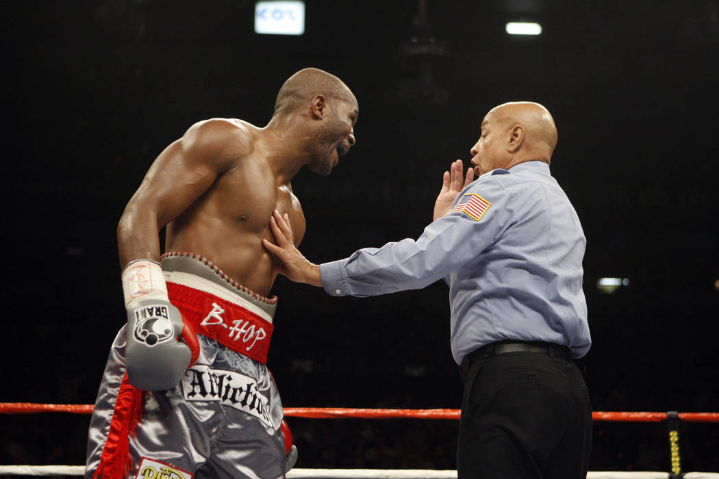 Bernard Hopkins, left, argues with Joe Cortez during the light heavyweight boxing match against Joe Calzaghe at the Thomas & Mack center in Las Vegas on Saturday, April 19, 2008. Calzaghe won  ...