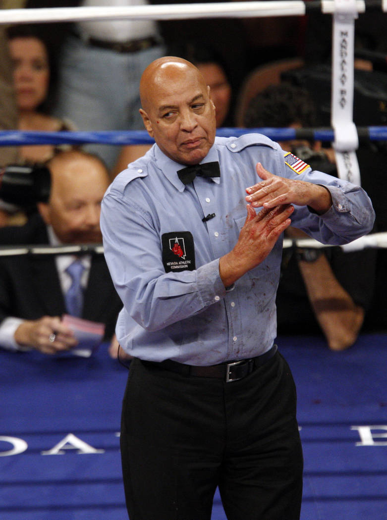 Ref Joe Cortez calls time to speak with ringside officials during the Humberto Soto - Francisco Lorenzo interim WBC super featherweight championship boxing match at Mandalay Bay hotel and Casino i ...