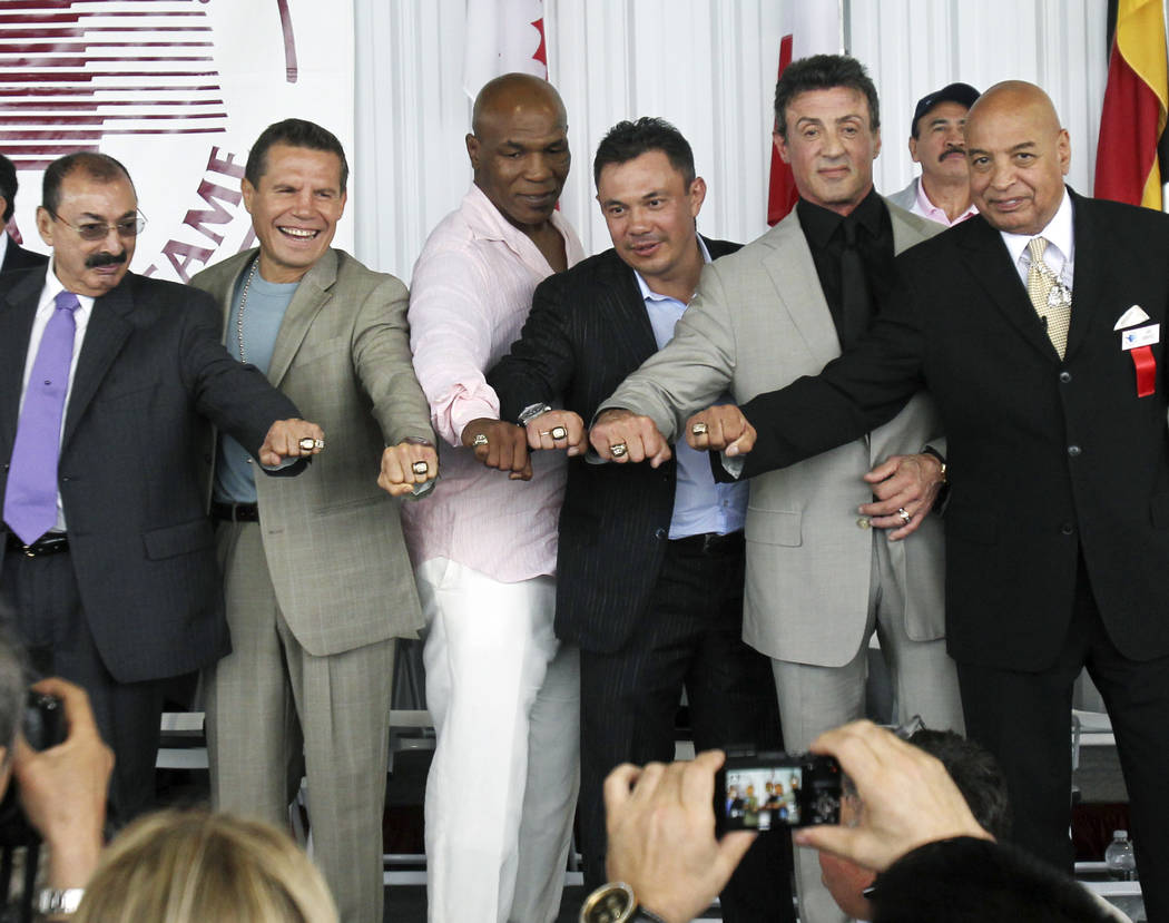 Boxing Hall of Fame inductees pose with their rings after a ceremony in Canastota, N.Y., on Sunday, June 12, 2011. From left are trainer Nacho Beristain, of Mexico; Julio Cesar Chavez, of Mexico;  ...