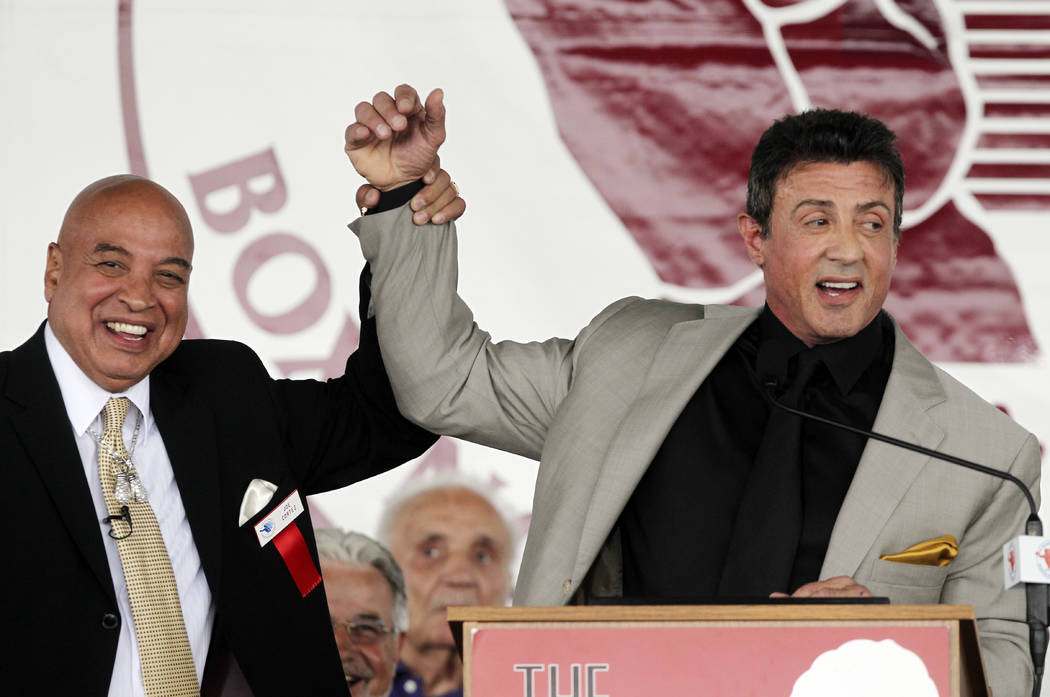Referee Joe Cortez, left, and Sylvester Stallone on stage at the Boxing Hall of Fame induction ceremony in Canastota, N.Y., on Sunday, June 12, 2011.   (AP Photo/Mike Groll)