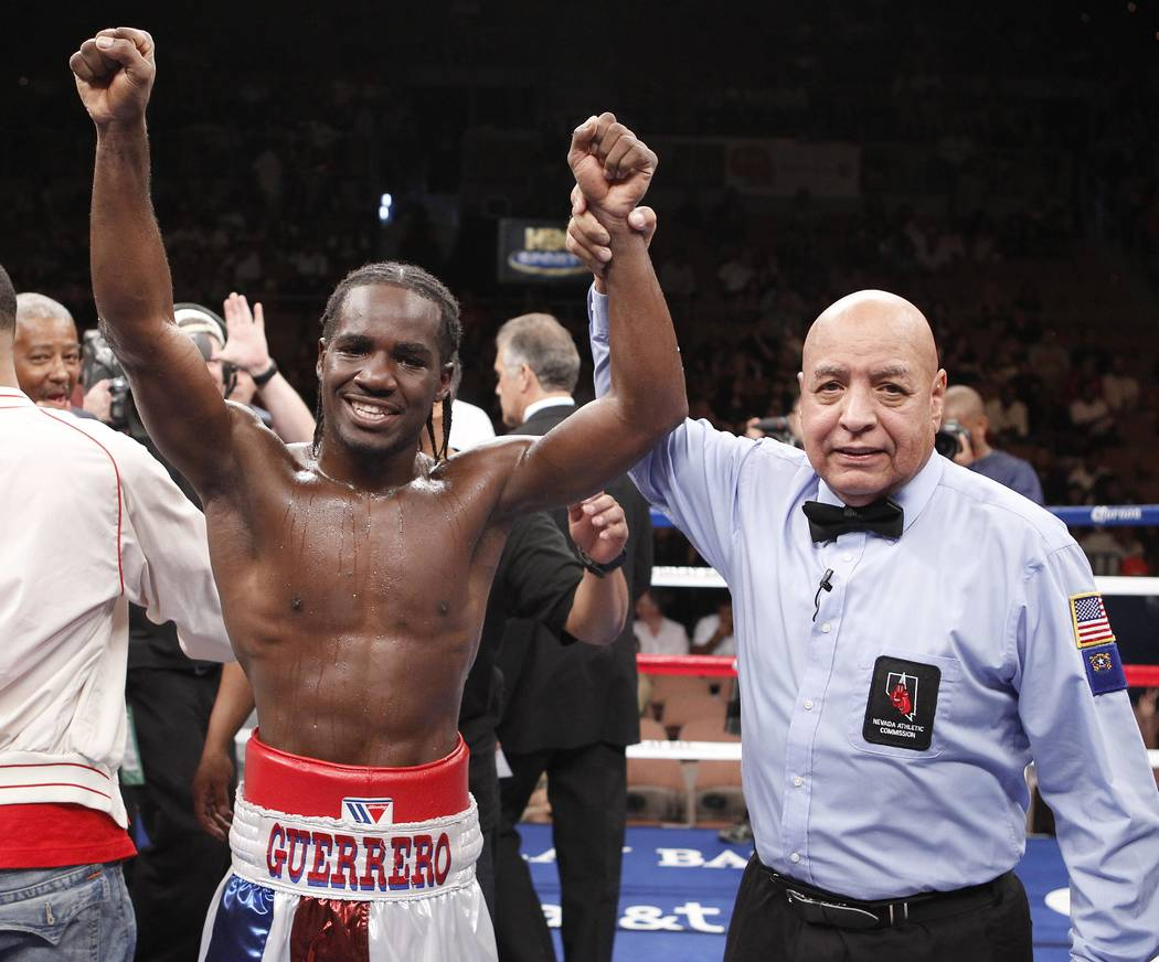 Fernando Guerrero, of the United States, is declared the winner by referee Joe Cortez after defeating Jose Medina, of the United States, shortly after their super middleweight boxing match, Saturd ...