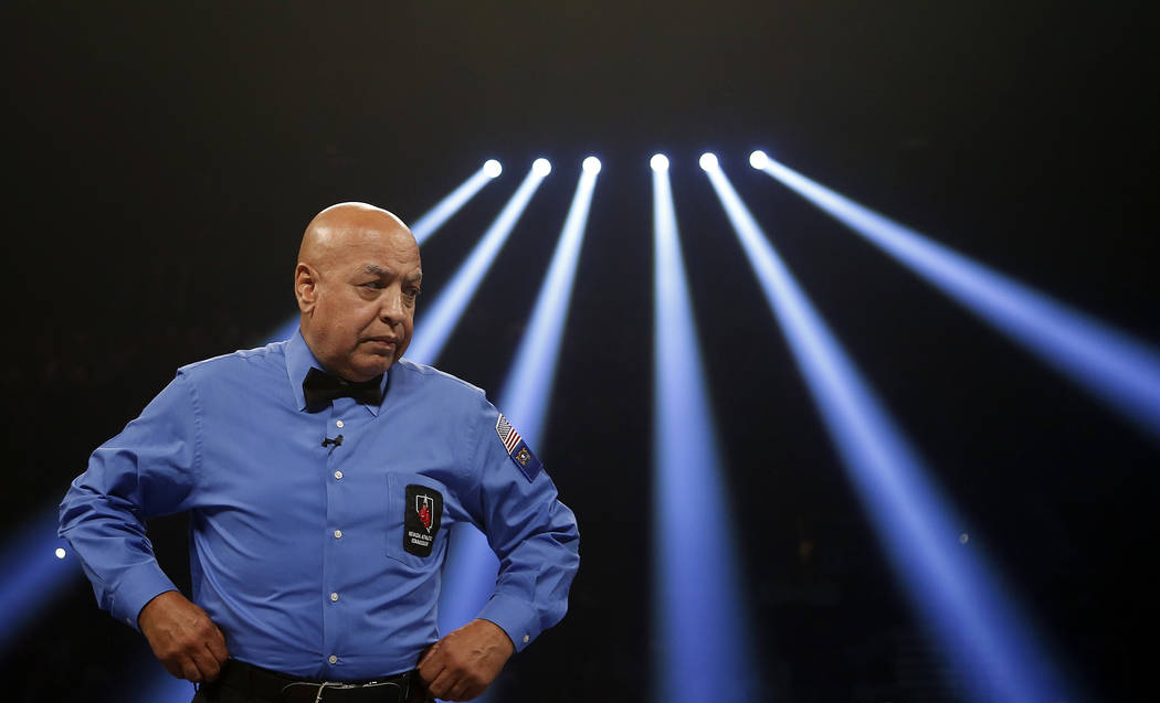 Boxing hall-of-fame referee Joe Cortez prepares to officiate his final boxing match before retiring between Canelo Alvarez, of Mexico, and Josesito Lopez on Saturday, Sept. 15, 2012, in Las Vegas. ...