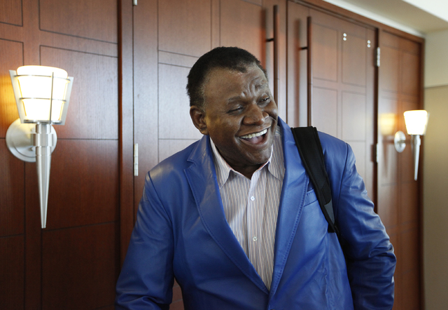 Comedian George Wallace smiles outside of court in Las Vegas Tuesday, April 8, 2014 after a jury awarded him $1.3 million for negligence on the part of the Bellagio for a 2007 incident where he wa ...