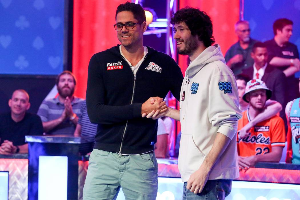Benjamin Pollak, left, shakes hands with Dan Ott, right,  at the World Series of Poker final table at the Rio Convention Center in Las Vegas on Saturday, July 22, 2017.  Bridget Bennett Las Vegas  ...