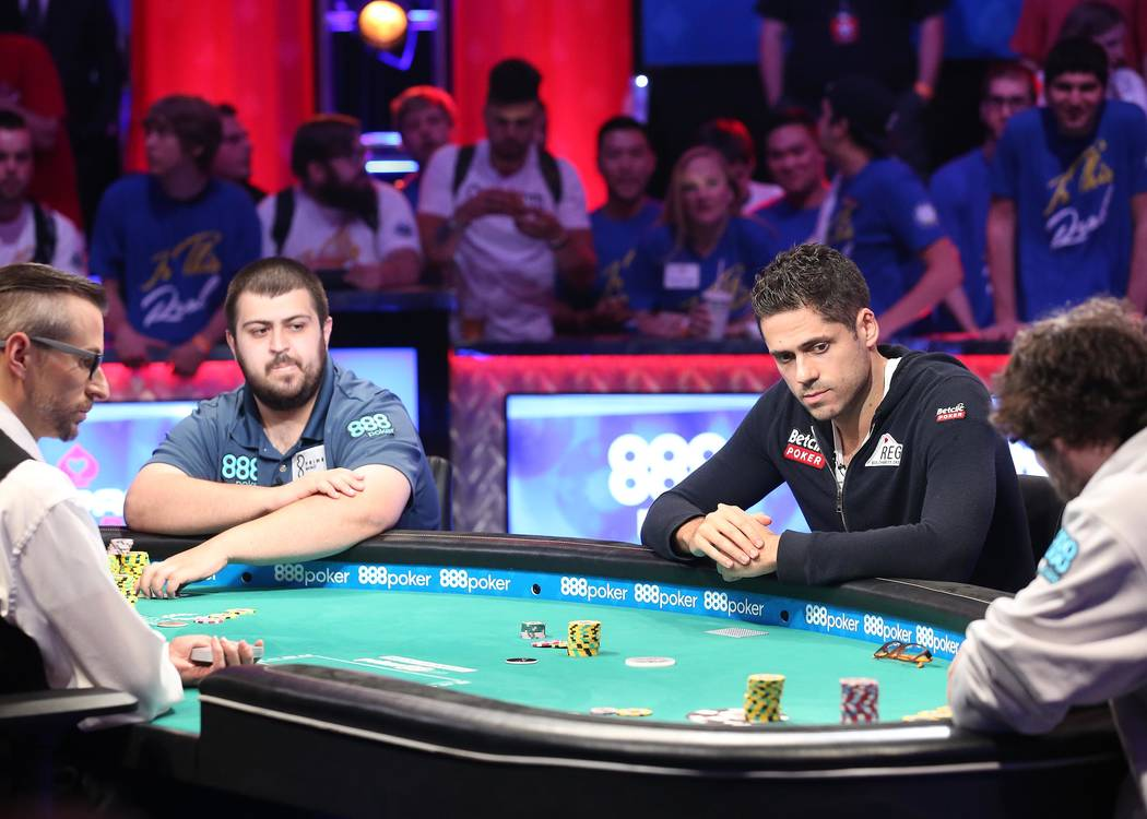 The final three including Scott Blumstein, left, Benjamin Pollak, center, and Dan Ott, far right, play at the World Series of Poker final table at the Rio Convention Center in Las Vegas on Saturda ...