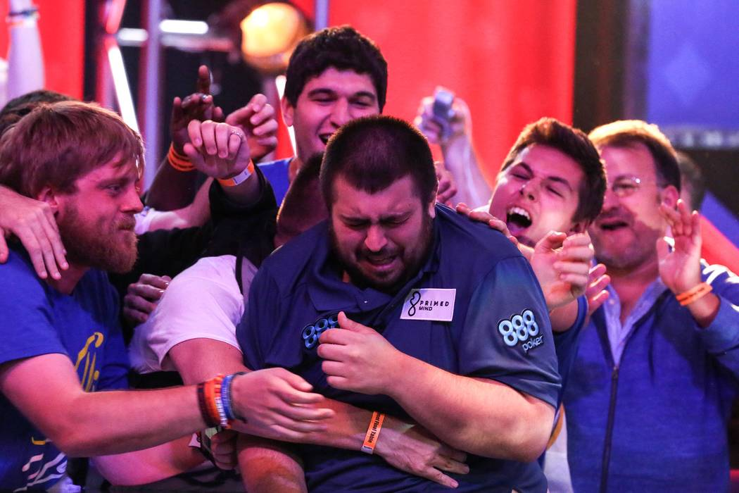 Fans embrace Scott Blumstein as he becomes the 2017 World Series of Poker champion at the World Series of Poker final table at Rio Convention Center in Las Vegas on Saturday, July 22, 2017.  Bridg ...