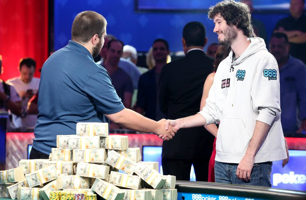 Scott Blumstein, the 2017 World Series of Poker champion, left, shakes hand with Dan Ott, who placed second at the World Series of Poker final table at Rio Convention Center in Las Vegas on Saturd ...