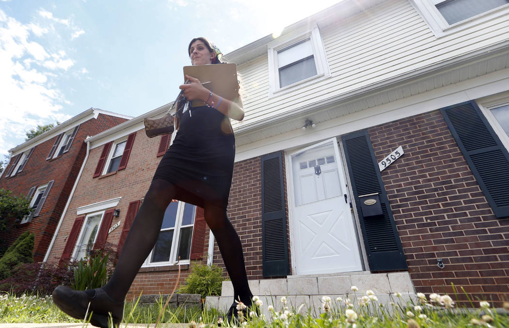 Democratic nominee for the House of Delegates 13th district seat, Danica Roem, walks from a home as she canvasses a neighborhood Wednesday, June 21, 2017, in Manassas, Va. Roem handily won a four- ...