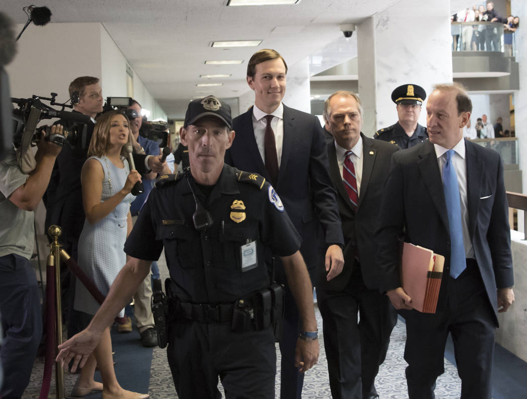 White House senior adviser Jared Kushner, center, accompanied by his attorney Abbe Lowell, right, arrives on Capitol Hill in Washington, Monday, July 24, 2017, to meet behind closed doors before t ...