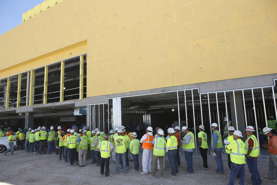 Construction workers stand in line to eat during a topping off ceremony at the Golden Knights' practice facility location on Friday, April 21, 2017, in Las Vegas. Christian K. Lee Las Vegas Review ...