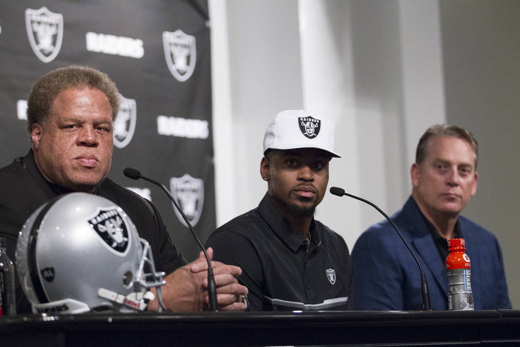 Oakland Raiders General Manager Reggie McKenzie, from left, NFL Draft first round pick Gareon Conley of Ohio State and head coach Jack Del Rio, during a press conference at the Raiders Headquarter ...