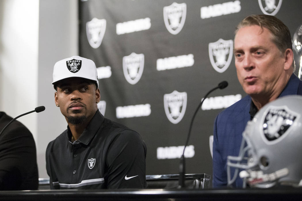 Oakland Raiders first round NFL draft pick Gareon Conley of Ohio State, left, listens to head coach Jack Del Rio during a press conference at the Raiders Headquarters on Friday, April 28, 2017, in ...