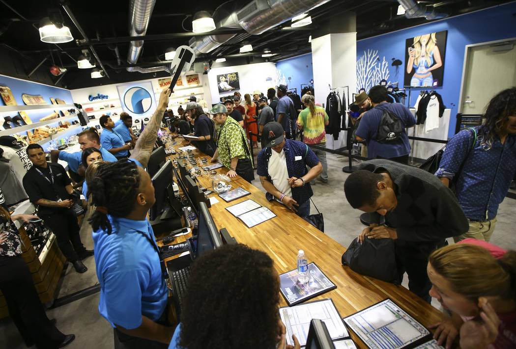 Customers line up to be some of the first people to legally purchase recreational marijuana at Reef Dispensaries in Las Vegas on Saturday, July 1, 2017. (Chase Stevens/Las Vegas Review-Journal) @c ...